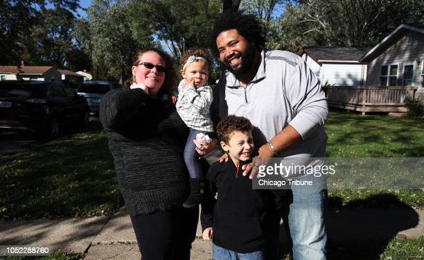 Nikki Chapman left and her husband Kay Chapman are seen with their children Liam age 7 and Abie age 1 near their home in Posen Ill on Thursday Oct 11...