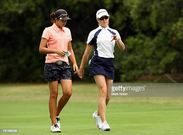 Nikki Garrett of Australia and Natalie Gulbis of the USA walk the fairway together during day one of the 2007 MFS Womens Australian Open at The Royal...