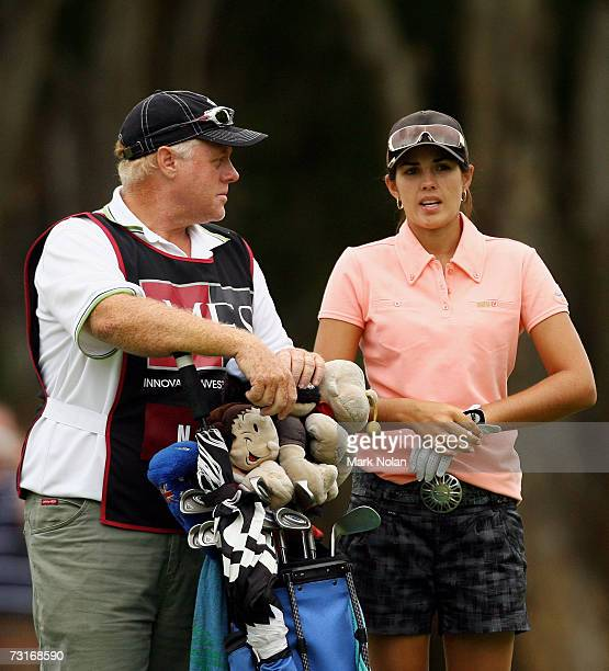 Nikki Garrett of Australia talks tactics with her caddy during day one of the 2007 MFS Womens Australian Open at The Royal Sydney Golf Club February...