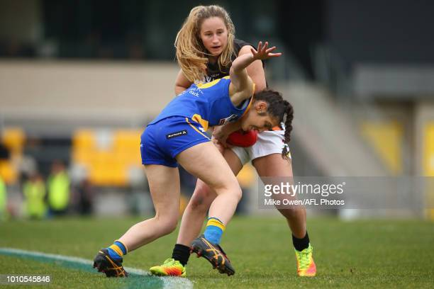 Nikki Gore of the Thunder is tackled by Jessica Bartolo of Williamstown during the round 13 VFLW match between North Melbourne and NT Thunder at...