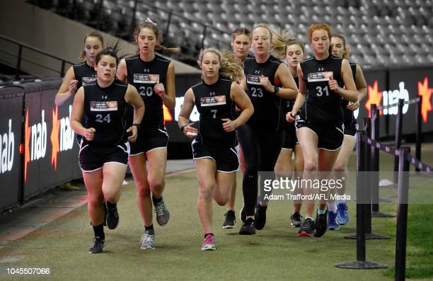 Nikki Gore performs in the 2km time trial during the AFLW Draft Combine at Marvel Stadium on October 3 2018 in Melbourne Australia