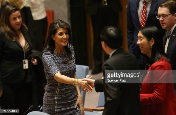 Nikki Haley the United States Ambassador to the United Nations speaks with Deputy Permanent Representative Ambassador Wu Haitao before members of the...