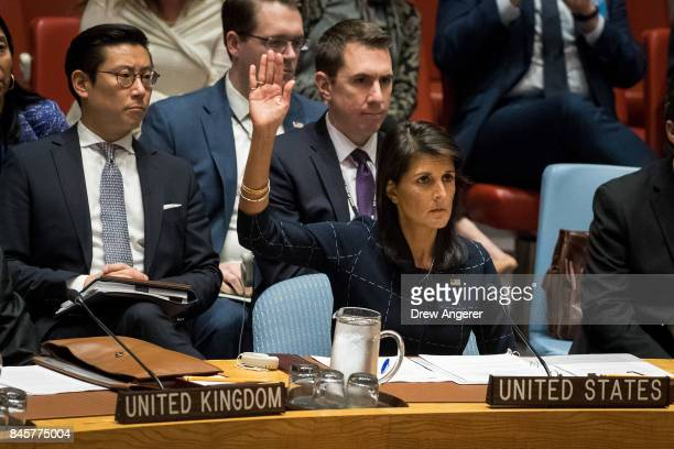 Nikki Haley United States ambassador to the United Nations raises her hand as she votes yes to levy new sanctions on North Korea designed to curb...