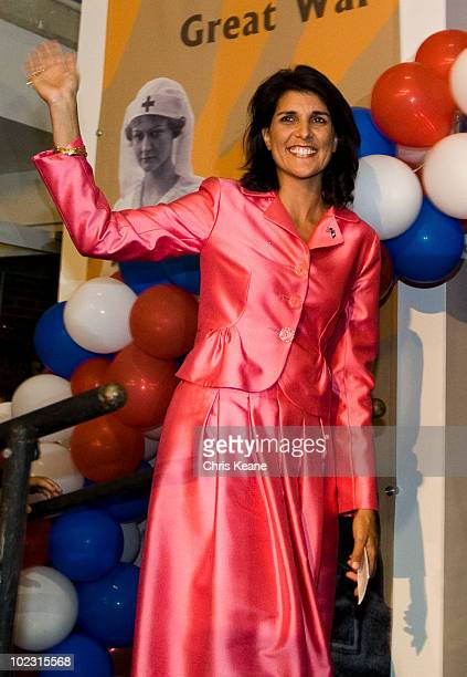 Nikki Haley waves to supporters as she comes onto stage during an election party for Republican South Carolina Governor candidate Nikki Haley at the...