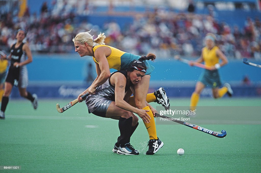 Nikki Hudson Of The Australia Womens Field Hockey Team Clashes With Caryn Paewai New Zealand