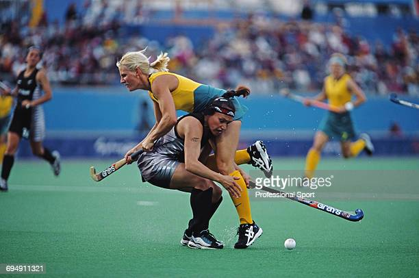 Nikki Hudson of the Australia Women's Field Hockey team clashes with Caryn Paewai of New Zealand in the medal round match between Australia and New...
