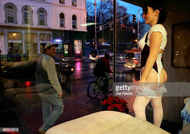 Nikki Hunt models lingerie in the store front window of Spellbound, a lingerie store, December 2, 2005 in Augusta, Maine. Spellbound started to use...