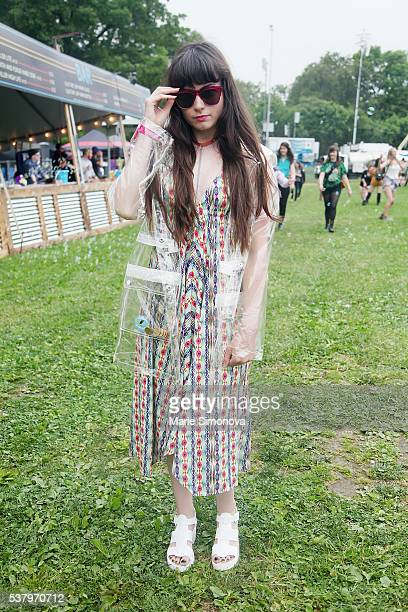 Nikki Jumper wearing Top Shop coat Pilyq dress JuJu UK shoes handmade necklace and Wildfix sunglasses at Randall's Island on June 3 2016 in New York...