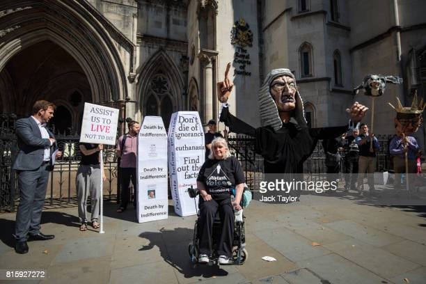 Nikki Kenward from the group Distant Voices who oppose the liberalisation of euthanasia laws poses in front of a demonstration featuring a giant...