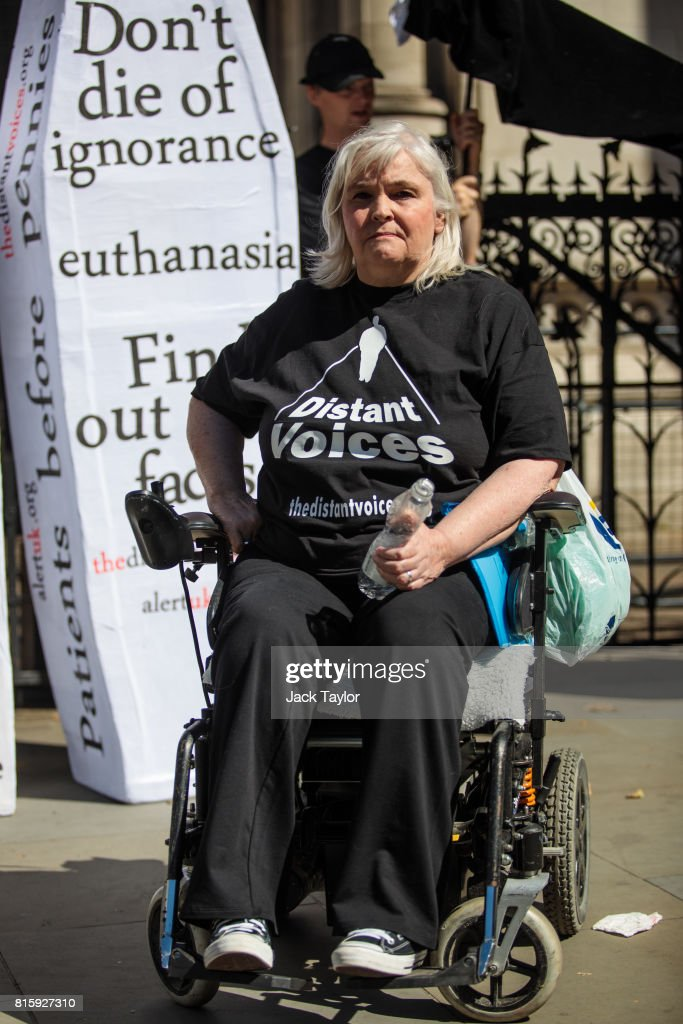 Nikki Kenward from the group Distant Voices, who oppose the liberalisation of euthanasia laws, poses outside the Royal Courts of Justice, Strand on July 17, 2017 in London, England. Noel Conway, 67, who is terminally ill with motor neurone disease, is seeking a legal challenge on the law banning assisted dying.