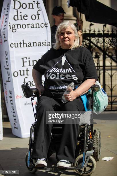Nikki Kenward from the group Distant Voices who oppose the liberalisation of euthanasia laws poses outside the Royal Courts of Justice Strand on July...