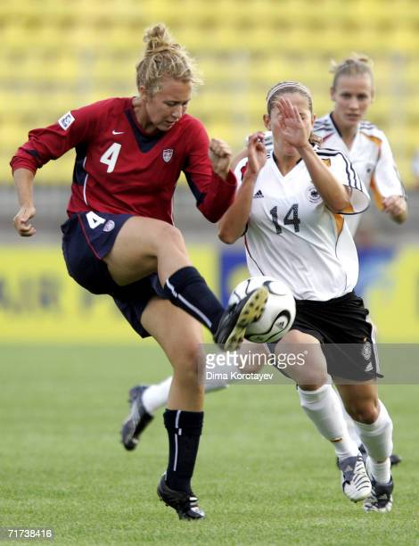 Nikki Krzysik of the United States challenge Anna Blaesse of Germany during the FIFA Women's Under 20 World Championships Quarter-final match between...