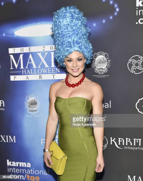 Nikki Leigh arrives at the 2017 MAXIM Halloween Party at LA Center Studios on October 21 2017 in Los Angeles California