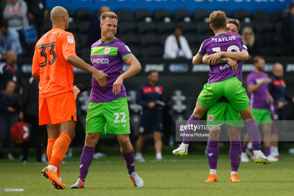 Nikki Maenpaa, Tomas Kalas and Matty Taylor of Bristol City celebrate their win after the Sky Bet Championship match between Swansea City and Bristol City at the Liberty Stadium on August 25, 2018 in Swansea, Wales.