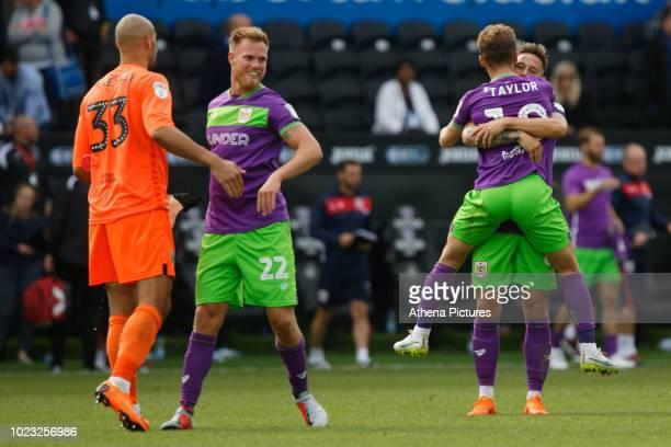 Nikki Maenpaa Tomas Kalas and Matty Taylor of Bristol City celebrate their win after the Sky Bet Championship match between Swansea City and Bristol...