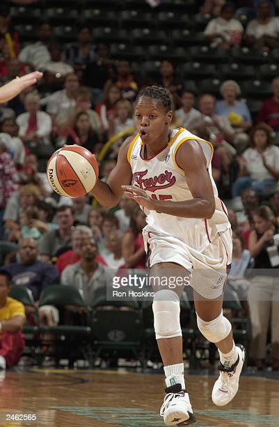 Nikki McCray of the Indiana Fever drives with the ball against the Cleveland Rockers during the game at Conseco Fieldhouse on August 23 2003 in...