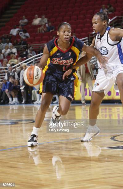 Nikki McCray of the Indiana Fever goes up againt Elaine Powell of the Orlando Miracle in the game on June 11 2002 at TD Waterhouse Centre in Orlando...