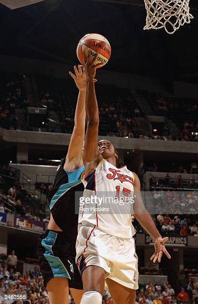 Nikki McCray of the Indiana Fever shoots a layup against the Cleveland Rockers during the game at Conseco Fieldhouse on August 23 2003 in...