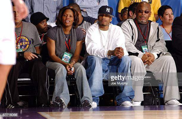 Nikki McCray of the Phoenix Mercury and Allen Iverson of the Philadelphia 76ers watch the McDonald's NBA AllStar Celebrity Game at the Denver...
