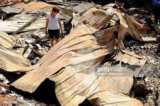 Nikki McManus the girlfriend of Dave Barnett looks through what is left of her boyfriend's completely destroyed house Dave Barnett lost everything in...