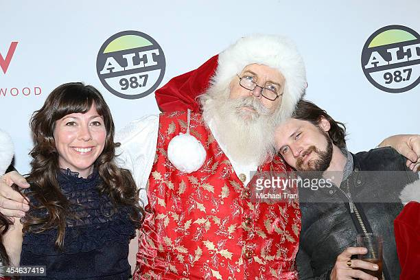 Nikki Monninger and Brian Aubert of Silversun Pickups with Santa attend The ALTimate Rooftop Christmas party held at W Hollywood on December 9 2013...