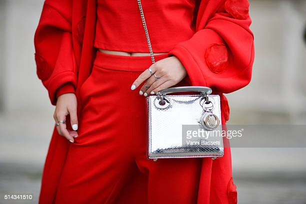 Nikki Nier poses with a Dior bag after the Shiatzy Chen show at the Grand Palais during Paris Fashion Week FW 16/17 on March 8, 2016 in Paris, France.