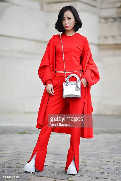 Nikki Nier poses with a Dior bag after the Shiatzy Chen show at the Grand Palais during Paris Fashion Week FW 16/17 on March 8 2016 in Paris France