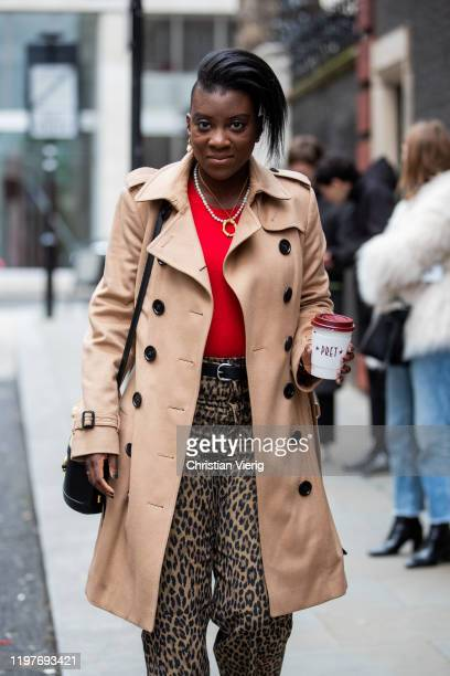 Nikki Ogunnaike is seen wearing beige double breasted trench coat, pants with leopard print, beige black two tone bag outside Chalayan during London...