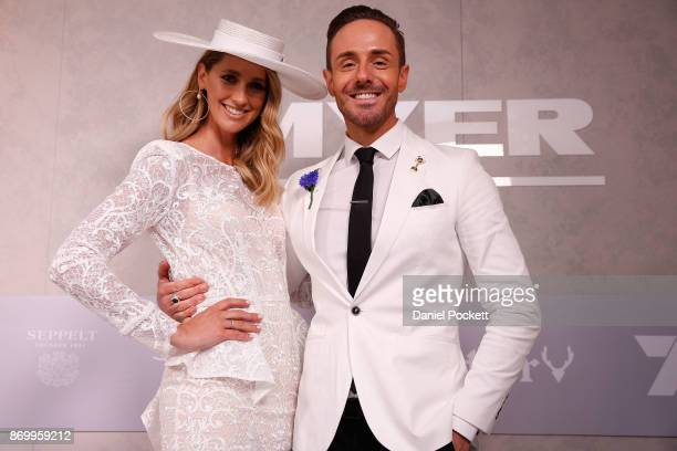 Nikki Phillips and Donny Galella pose at the Myer Fashion on the Field Marquee on AAMI Victoria Derby Day at Flemington Racecourse on November 4 2017...