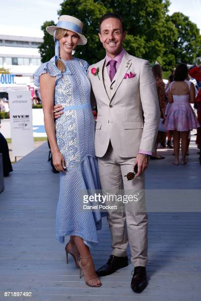 Nikki Phillips and Donny Galella pose on Kennedy Oaks Day at Flemington Racecourse on November 9 2017 in Melbourne Australia