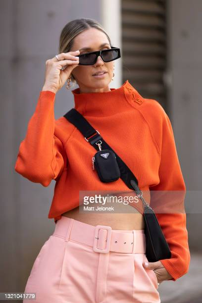 Nikki Phillips is seen wearing an AJE jack, Prada bag, Dior glasses, Zara pants and earrings with AJE shoes at Afterpay Australian Fashion Week 2021...