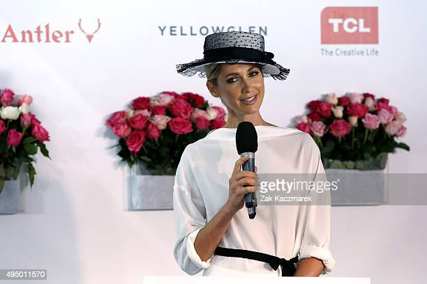 Nikki Phillips speaks at the Fashion on the Field enclosure on Victoria Derby Day at Flemington Racecourse on October 31 2015 in Melbourne Australia