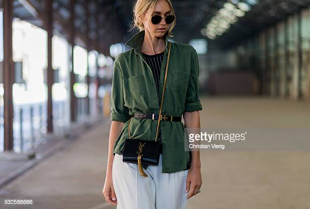 SYDNEY AUSTRALIA MAY 19 Nikki Phillips wearing a black white striped shirt from Finders Keepers an olive jacket from Watson x Watson and white wide...