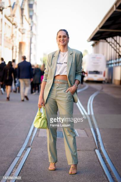 Nikki Phillips wearing Balenciaga white t-shirt, ASOS suit and Bottega Veneta bag at Afterpay Australian Fashion Week 2021 on May 31, 2021 in Sydney,...