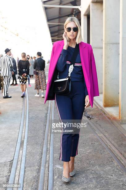 Nikki Phillips wearing Life With Bird jacket Vero Moda track suit Isabel Marant shoes and Prada bag during MercedesBenz Fashion Week Resort 19...