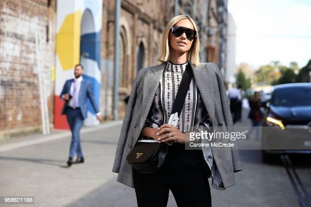 Nikki Phillips wearing Zara jacket Fendi sunglasses Prada handbag We Are Kindred top and Maticevski pants during MercedesBenz Fashion Week Resort 19...