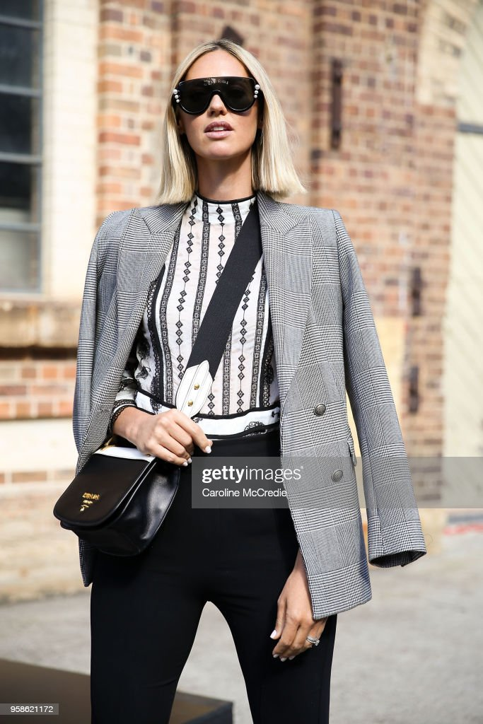 Nikki Phillips wearing Zara jacket, Fendi sunglasses, Prada handbag, We Are Kindred top and Maticevski pants during Mercedes-Benz Fashion Week Resort 19 Collections at Carriageworks on May 15, 2018 in Sydney, Australia.