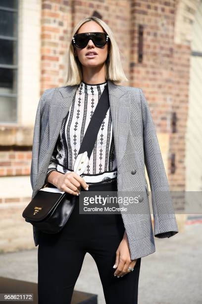 Nikki Phillips wearing Zara jacket Fendi sunglasses Prada handbag We Are Kindred top and Maticevski pants during MercedesBenz Fashion Week Resort 19...
