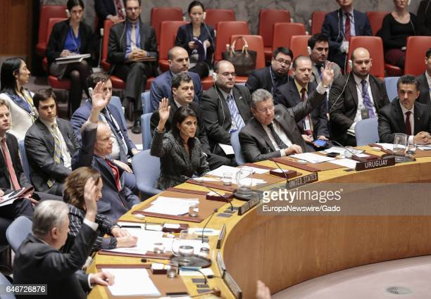Nikki R Haley United States Permanent Representative to the UN and other dignitaries raising their hands during the Security Council meeting on...