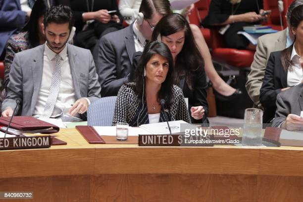 Nikki R Haley United States Permanent Representative to the UN listens gravely to translated audio during a Security Council meeting about North...