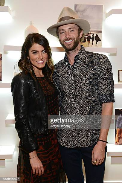 Nikki Reed and Paul McDonald attend Timberland Acoustic Night In at Bollare showroom on December 12 2013 in Los Angeles California