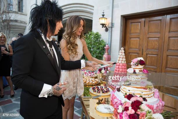 Nikki Sixx and Courtney Sixx cut their wedding cake at their wedding at Greystone Mansion on March 15 2014 in Beverly Hills California