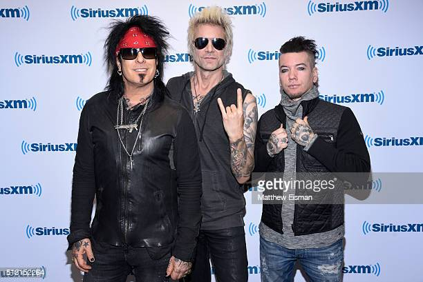 Nikki Sixx James Michael and DJ Ashba of the band SixxAM visit at SiriusXM Studios on February 29 2016 in New York City