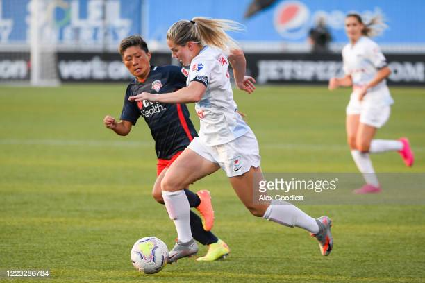 Nikki Stanton of Chicago Red Stars drives into Kumi Yokoyama of the Washington Spirit in the first round of the NWSL Challenge Cup at Zions Bank...