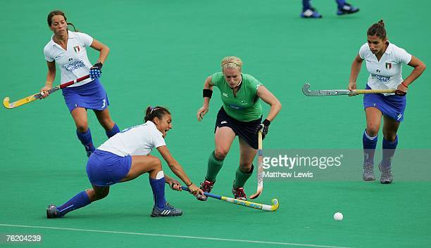 Nikki Symmons of Ireland betas the challenge from Carolina Scandroli of Italy during the Women's match between the Ireland and Italy on day four of...