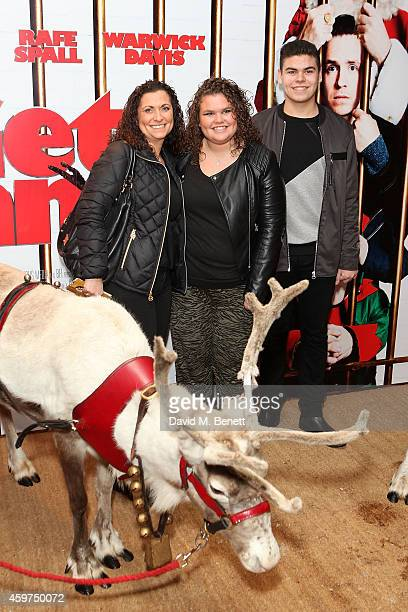 Nikki Tapper Amy Tapper and Josh Tapper attend the UK Premiere of 'Get Santa' at Vue West End on November 30 2014 in London England