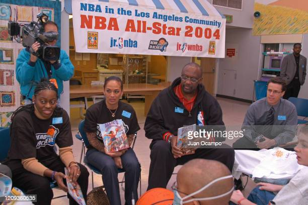 Nikki Teasley of the Los Angeles Sparks Kay Malone and NBA legend Bob Lanier speak to children during a Read to Achieve Hospital Visit as part of...