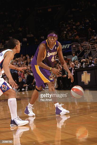 Nikki Teasley of the Los Angeles Sparks looks to pass against Teresa Weatherspoon of the New York Liberty during the WNBA game at Madison Square...