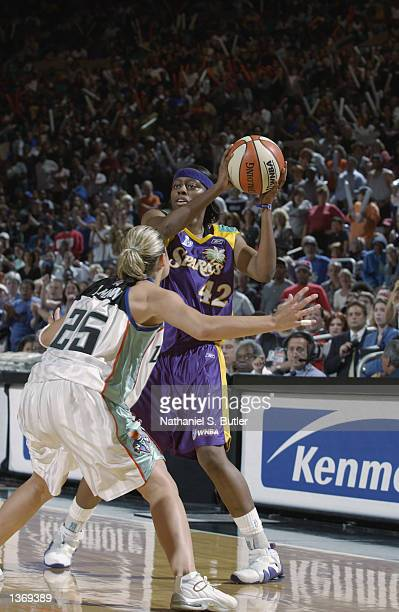 Nikki Teasley of the Los Angeles Sparks looks to pass over Becky Hammon of the New York Liberty during Game one of the 2002 WNBA Finals on August 29...