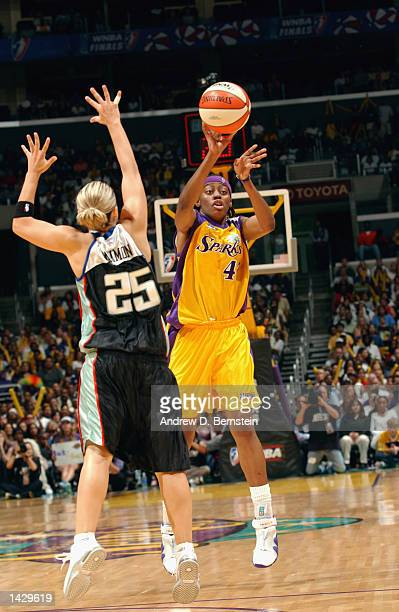 Nikki Teasley of the Los Angeles Sparks passes around Becky Hammon of the New York Liberty during Game two of the 2002 WNBA Finals on August 31 2002...